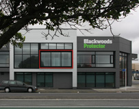 Modern striking commercial building. Grey aluminium weatherboard cladding system with black high performance window system. Bold red box bi-fold door feature element. Blackwoods Protector retail store. Grey cladding panel. Wellington architecture in Peton